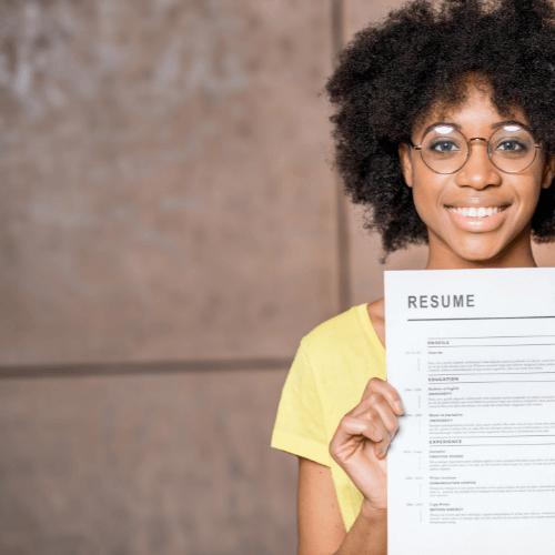 woman handing over her resume