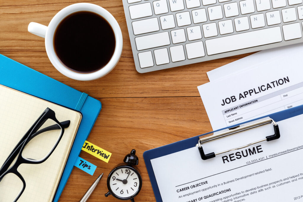 job search with resume objective and job application on computer work table background